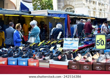 LEUVEN, BELGIUM-SEPTEMBER 12, 2014: Thanks to modern technologies the buyers on street market can pay using their credit cards and not only by cash - stock photo
