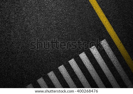 Level asphalted road with a dividing stripes and pedestrian crossing. The texture of the tarmac, top view. - stock photo