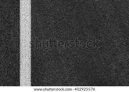 Level asphalted road with a dividing white stripes. The texture of the tarmac, top view.