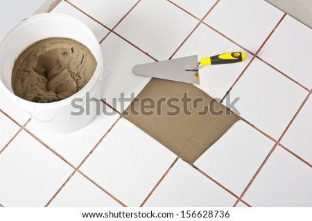 level tool on cement floor - stock photo