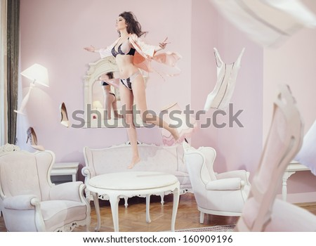 stock photo levitating brunette beauty 160909196 woman levitating stock images, royalty free images & vectors  at bayanpartner.co