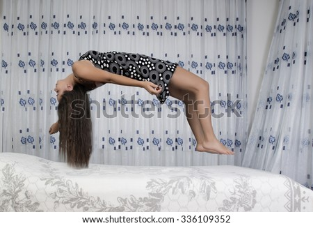 Levitating girl sleeping over the bed - stock photo