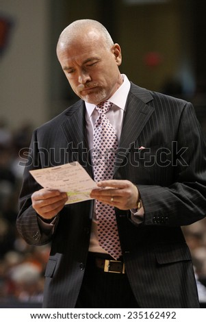 LEWISBURG, PA. - NOVEMBER 28: Penn State's Coach Pat Chambers looks at his notes during a basketball game against Bucknell  on November 28, 2014  Sojka Pavilion in Lewisburg, PA. - stock photo