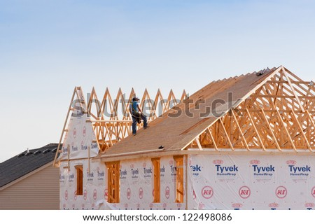 LEXINGTON, KY-DECEMBER 3: New house contraction in Lexington, Kentucky on December 3,2012.  Regarding   the U.S. Census Bureau 306  thousands new houses has been sold in United States  in  2011 year. - stock photo