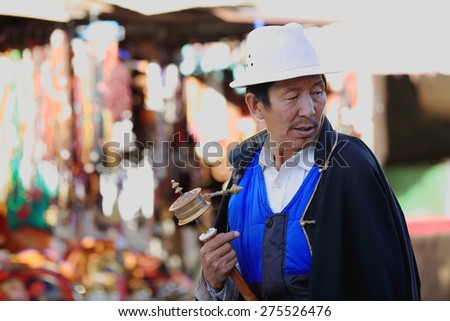 LHASA, TIBET, CHINA - OCTOBER 19: Tibetan buddhist devotee does the Kora-clockwise circumambulation around the Jokhang-House of Buddha temple on October 19, 2012 in Lhasa-Tibet.