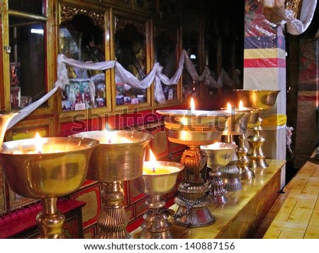 LHASA, TIBET-NOVEMBER 14: The Ani Sangkhung Nunnery burning candles. The Ani Sangkhung Nunnery is one of the oldest and most active nunneries in Tibet. November 14, 2004 in Lhasa, Tibet