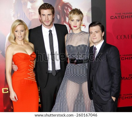 """Liam Hemsworth, Elizabeth Banks, Jennifer Lawrence and Josh Hutcherson at the Los Angeles premiere of """"The Hunger Games: Catching Fire"""" held at the Nokia Theatre in Los Angeles on November 18, 2013. - stock photo"""