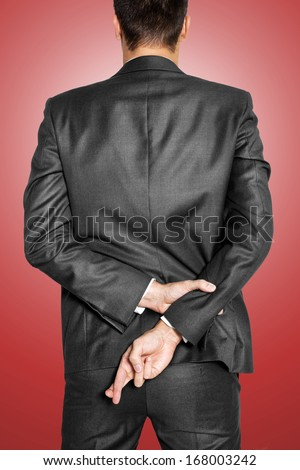 Liar businessman cross his finger - stock photo