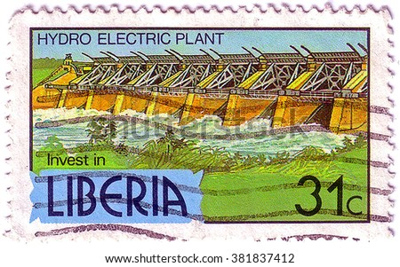 LIBERIA - CIRCA 1981: A 31-cent stamp printed in Liberia shows a hydro electric plant to encourage investment, circa 1981 - stock photo