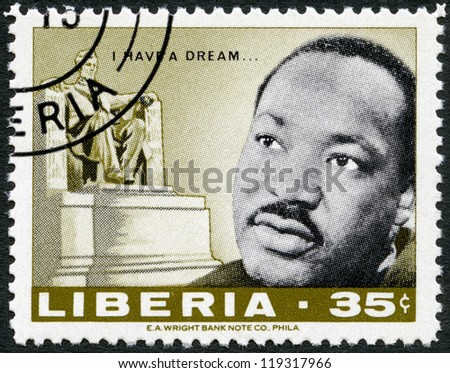 LIBERIA - CIRCA 1968: A stamp printed in Liberia shows Martin Luther King Jr. (1929 - 1968), American civil rights leader, and Lincoln monument by Daniel Chester French, circa 1968 - stock photo