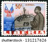 LIBERIA-CIRCA 1962: A stamp printed in Liberia shows president Tubman (1895-1971), Statue of Liberty, New York Skyline and Flags of US and Liberia, president Tubman�¢??s visit to US in 1961, circa 1962 - stock photo