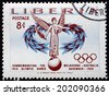 LIBERIA - CIRCA 1956: a stamp printed in the Liberia shows Goddess of Victory and Olympic Symbols, 1956 Summer Olympic Games, Melbourne, circa 1956 - stock photo