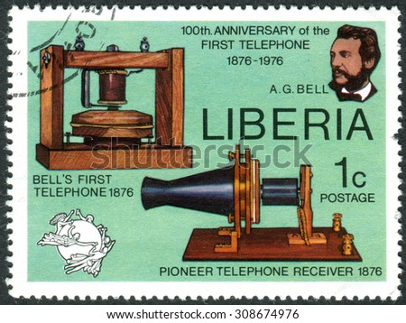 LIBERIA - CIRCA 1976: Postage stamp printed in Liberia, is devoted to Cent. of 1st telephone call by Alexander Graham Bell, shows AG Bell, Telephone and Receiver, UPU Emblem, circa 1976 - stock photo