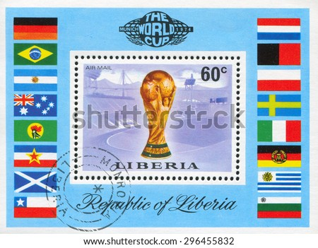 LIBERIA - CIRCA 1974: stamp printed by Liberia, shows Worls soccer championship cup, Munich stadium and flags, circa 1974 - stock photo