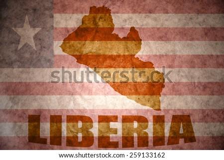 liberia map on a vintage liberian flag background - stock photo