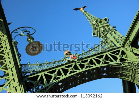 Liberty Bridge (sometimes Freedom Bridge) in Budapest, Hungary, connects Buda and Pest across the River Danube. - stock photo
