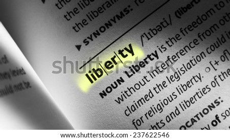liberty word written in open book