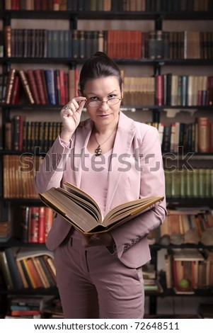 Librarian reading a thick book