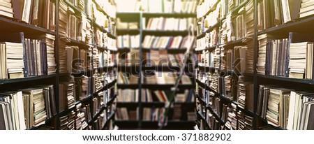 Library bookshelves background - stock photo
