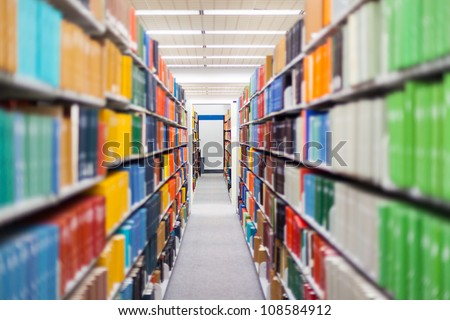 library setting with books and reading material (Please note that many books with legible titles are filler titles that only state the 'type' of materials contained within and date)