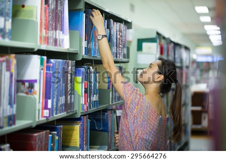 Library ,women student find book for study.