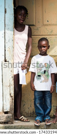 LIBREVILLE, GABON - MAR 6, 2013: Unidentified Gabonese mother and children at the porch in Gabon, Mar 6, 2013. People of Gabon suffer of poverty due to the unstable economical situation