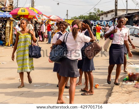LIBREVILLE, GABON - MAR 6, 2013: Unidentified Gabonese student in the multy crowded street in Gabon, Mar 6, 2013. People of Gabon suffer of poverty due to the unstable economical situation