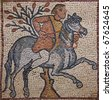 Libya Cyrenaica Qsar ancient well preserved Byzantine mosaic depicting a horseman and a tree - stock photo