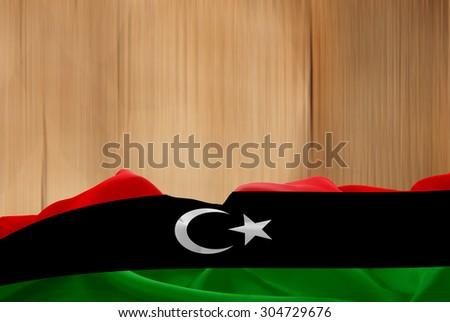Libya flag and wood background - stock photo