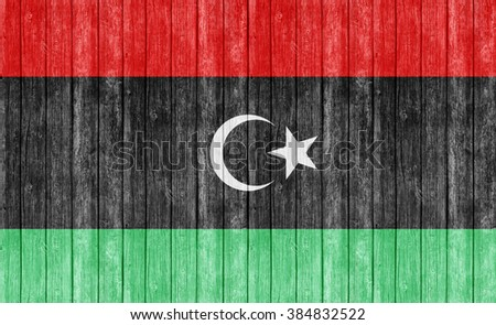 Libya flag on old wood texture background - stock photo