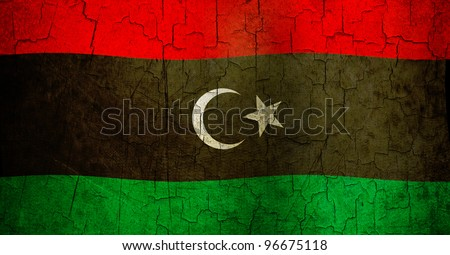 Libyan flag on a cracked grunge background - stock photo
