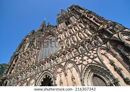 LICHFIELD, UK - SEPTEMBER 7.  With a history from the 7th century the present Gothic Cathedral dates from 1200 with carved stone decoration on  September 7, 2014 at Lichfield, Staffordshire, UK.