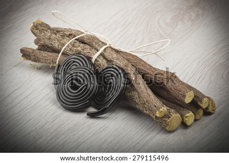 Licorice roots and licorice black on the white - stock photo