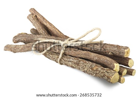 Licorice roots close up on the white - stock photo