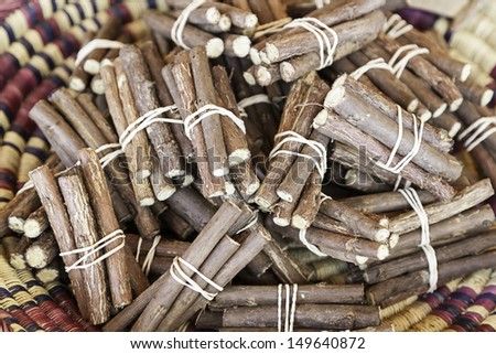 Licorice sticks, detail of fresh licorice sticks, craft sale in a market - stock photo