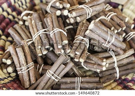 Licorice sticks, detail of fresh licorice sticks, craft sale in a market - stock photo