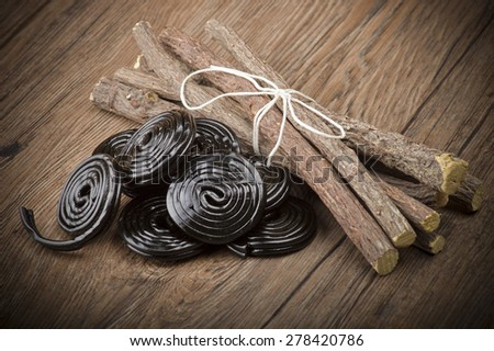 Licorice wheels candies close up on the wood - stock photo