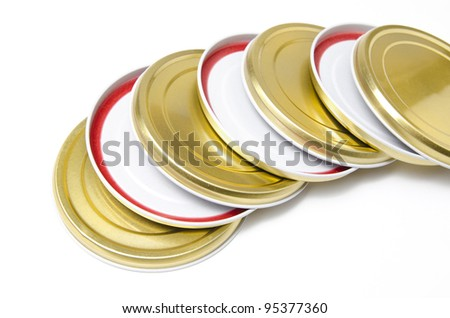 lids of jars arranged one above the other - stock photo