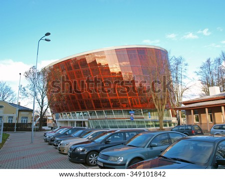 LIEPAJA, LATVIA - DECEMBER 1, 2015: Music hall is built in modern architecture style as skew cylinder from glass and metal constructions. It is named LIELAIS DZINTARS what does mean BIG AMBER. - stock photo
