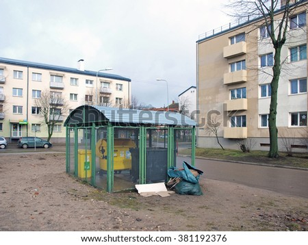 LIEPAJA, LATVIA - FEBRUARY 22, 2016: Near apartment houses is made special locked storage for waste containers.        - stock photo
