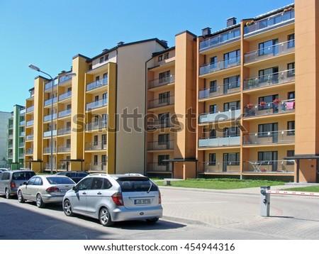 LIEPAJA, LATVIA - JULY 19, 2016: Newly built high-rise apartment buildings are located on Daugavas street.                       - stock photo