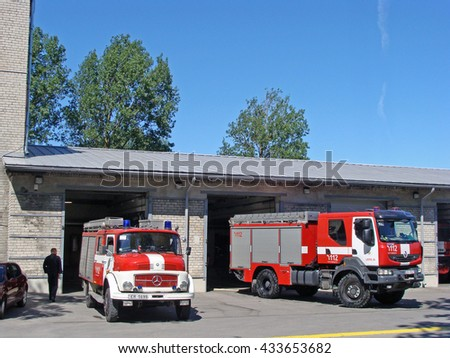 LIEPAJA, LATVIA - JUNE 6, 2016: Fire fighters and rescuers department trucks are based on fire station on Ganibu street.                              - stock photo