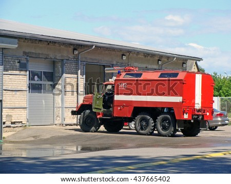 LIEPAJA, LATVIA - JUNE 6, 2016: Fire fighters and rescuers department trucks are based on fire station on Ganibu street and russian truck Ural is parked near garage. - stock photo