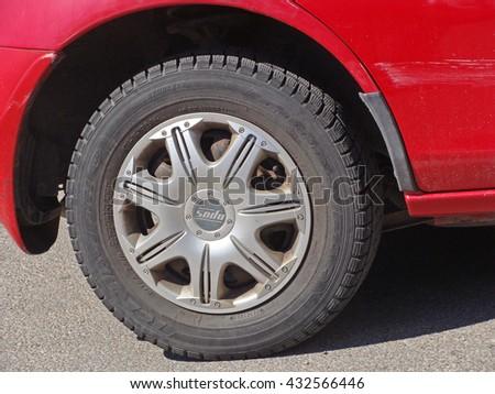 LIEPAJA, LATVIA - JUNE 6, 2016: Original design aluminum alloy wheels are mounted on red color car. - stock photo