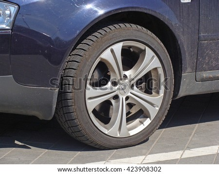 LIEPAJA, LATVIA - MAY 19, 2016: Car on parking has wheel with light weight aluminum alloy disk.