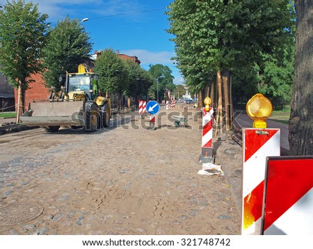 LIEPAJA, LATVIA - SEPTEMBER 28, 2015: Tram line and street repair takes place on Rigas street before bus and railway station. - stock photo