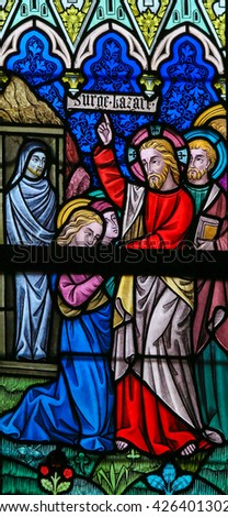 LIER, BELGIUM - MAY 16, 2015: Stained Glass window (1886) in St Gummarus Church in Lier, Belgium, depicting the Raising of Lazarus, a miracle performed by Jesus. - stock photo