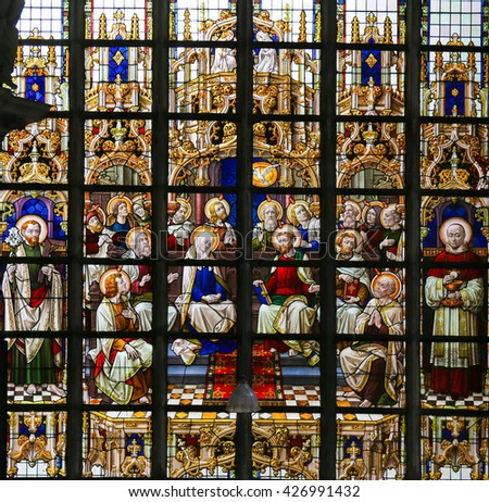 LIER, BELGIUM - MAY 16, 2015: Stained Glass window in St Gummarus Church in Lier, Belgium, depicting the gathering of Mary and the Apostles at Pentecost - stock photo