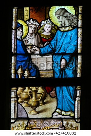 LIER, BELGIUM - MAY 16, 2015: Stained Glass window in St Gummarus Church in Lier, Belgium, depicting the Marriage at Cana or Wedding at Cana, a miracle attributed to Christ.