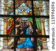 LIER - SEPT 15: Stained glass window depicting the Annunciation, in the church of Lier, Belgium, on September 15, 2012. - stock photo